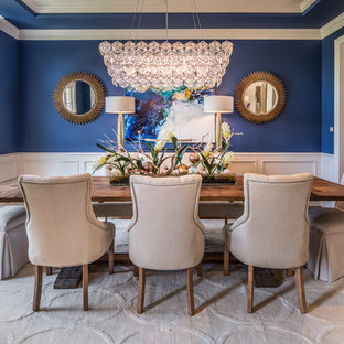 Large transitional brown floor and dark wood floor enclosed dining room photo in Houston with blue walls and no fireplace