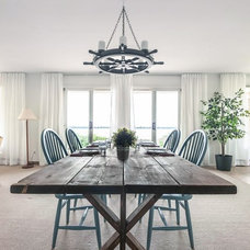 Beach Style Dining Room by DesignSense Interiors