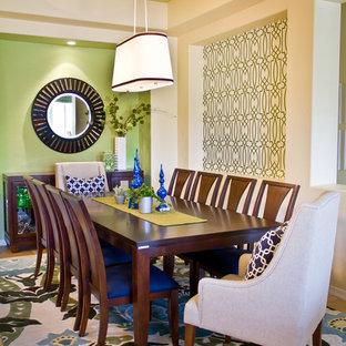 Immagine di una sala da pranzo design di medie dimensioni con pareti verdi e pavimento in gres porcellanato