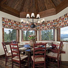 Rustic Dining Room by Bulhon Design Associates