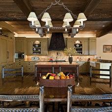 Rustic Dining Room by Bulhon Design Associates