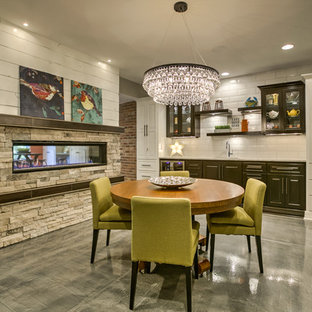Large transitional concrete floor and gray floor great room photo in Omaha with gray walls, a two-sided fireplace and a stone fireplace