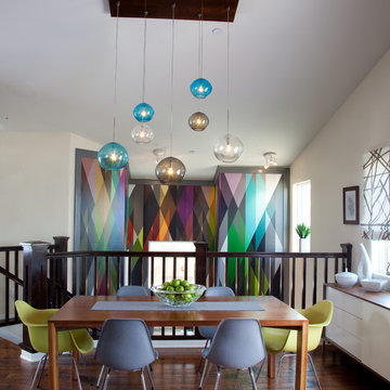Colorful stairwell, dining and living area