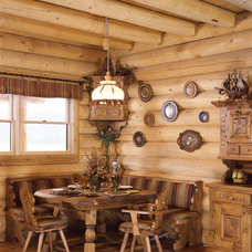 Rustic Dining Room by Country Charm Log Homes