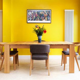 Modernes Esszimmer mit gelber Wandfarbe in London