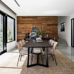 Photo of a large contemporary dining room in Perth with white walls, concrete floors and grey floor.