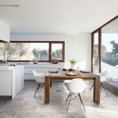 Example of a trendy kitchen/dining room combo design in Sydney
