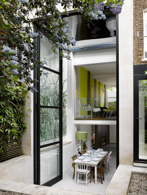 Contemporary Kitchen Dining Room Combo Idea In London With White Walls