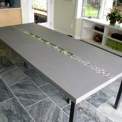 Concrete Rock Dining Table by Trueform Concrete - Concrete dining table photo shows an integral design detail that runs through the concrete table top.