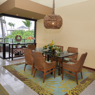 Photo of a medium sized world-inspired kitchen/dining room in Hawaii with beige walls, a hanging fireplace and beige floors.