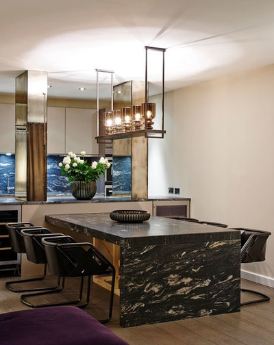 Contemporary Dining Room by Cue Design Agents