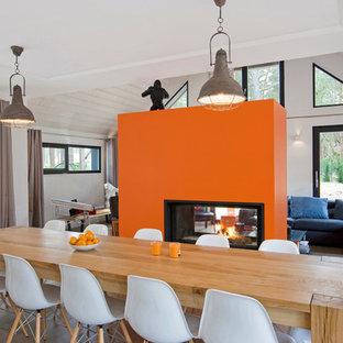 amnagement dune grande salle manger ouverte sur le salon contemporaine avec un mur