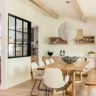 Inspiration for a contemporary light wood floor and beige floor dining room remodel in Boston with beige walls