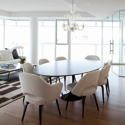 Inspiration for a contemporary medium tone wood floor dining room remodel in New York