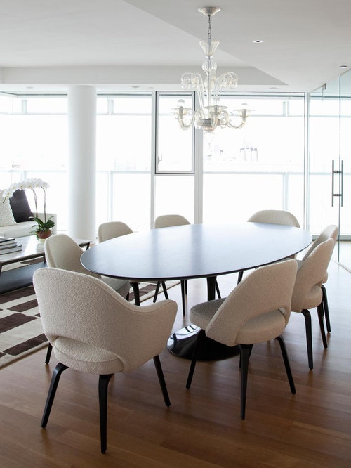 inspiration for a medium tone wood floor dining room remodel in new york