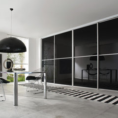 contemporary dining room by Cronos Design
