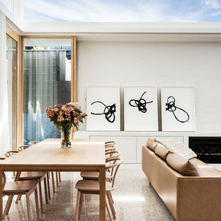 This is an example of a contemporary open plan dining in Sydney with white walls.