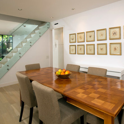 Example of a trendy dining room design in DC Metro with white walls