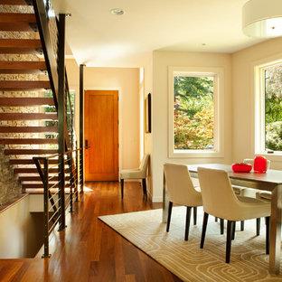 Dining room - contemporary dark wood floor dining room idea in Portland with beige walls