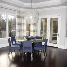 Contemporary Dining Room by Grainda Builders, Inc.