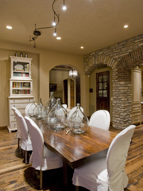 Mediterranean Dining Room Idea In Phoenix With Beige Walls And Dark Wood Floors
