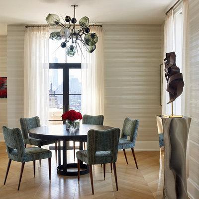 Trendy light wood floor dining room photo in New York with beige walls