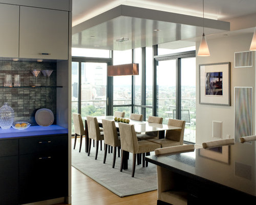 Example Of A Large Trendy Dining Room Design In Boston With Medium Tone Hardwood Floors