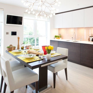 Design ideas for a contemporary kitchen/dining room in London with white walls and no fireplace.