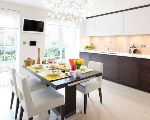 Inspiration For A Contemporary Kitchen/dining Room Combo Remodel In London  With White Walls