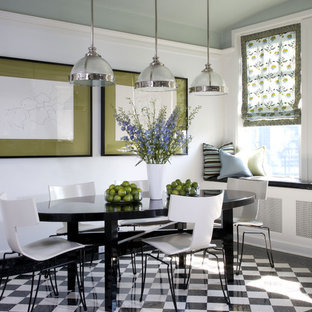 Example of a trendy ceramic tile and multicolored floor dining room design in Other with white walls