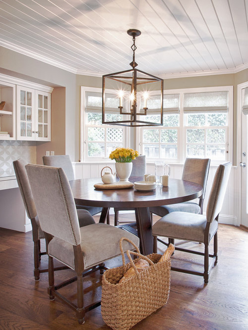 Example Of A Large Trendy Dark Wood Floor And Brown Enclosed Dining Room Design In