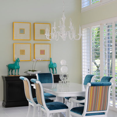Dining room - contemporary dining room idea in Miami with white walls