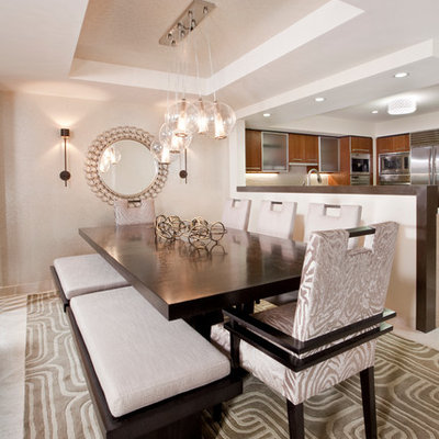 Inspiration for a contemporary kitchen/dining room combo remodel in Miami with beige walls