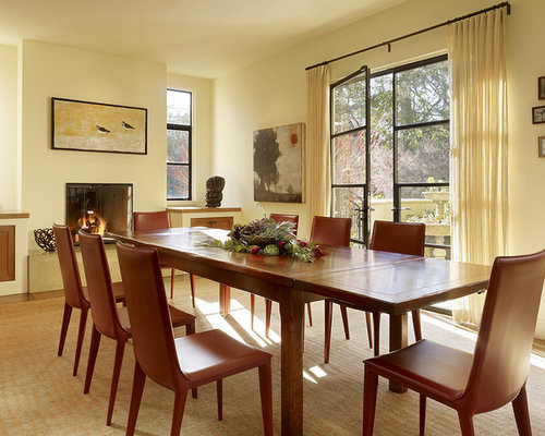 Example Of A Trendy Dining Room Design In San Francisco With Beige Walls And Standard
