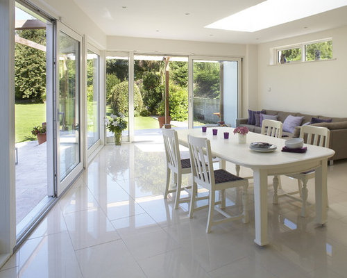 Inspiration For A Contemporary Ceramic Floor And White Dining Room Remodel In Dublin With