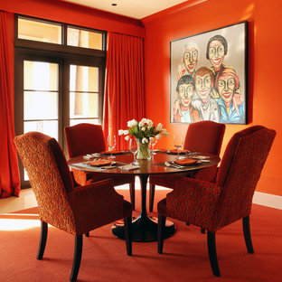Trendy carpeted and orange floor dining room photo in Other with red walls