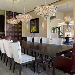 Inspiration for a contemporary medium tone wood floor dining room remodel in London with beige walls