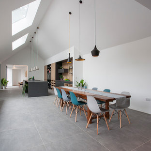 Contemporary kitchen/dining room in West Midlands with white walls and grey floors.