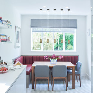 Inspiration for a contemporary kitchen/dining room in London with white walls.