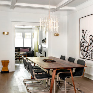 Trendy dark wood floor dining room photo in Toronto with white walls