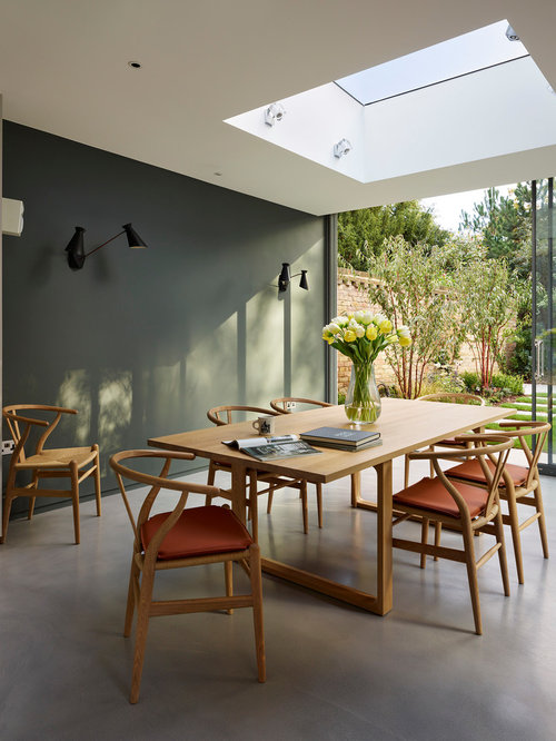 Perfect Trendy Concrete Floor Dining Room Photo In London With Gray Walls