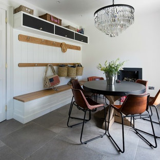 Inspiration for a medium sized contemporary dining room in Other with white walls, a wood burning stove and grey floors.