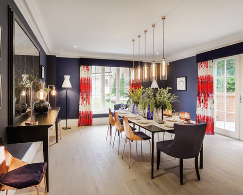This Is An Example Of A Large Contemporary Enclosed Dining Room In Hampshire With Blue Walls