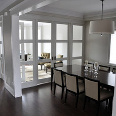 Contemporary Dining Room by Woodsmith Construction Inc