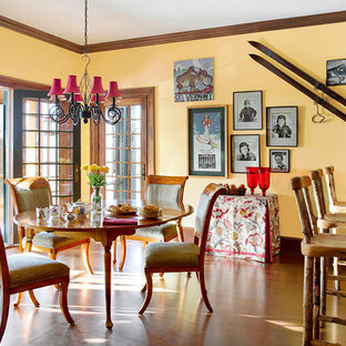 Inspiration for a traditional kitchen/dining room in Boston with yellow walls and medium hardwood flooring.