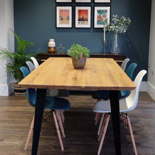 Dining room in Essex with white walls, dark hardwood flooring and brown floors.