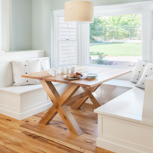 Large coastal medium tone wood floor dining room photo in Boston