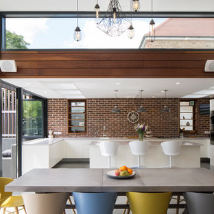 Medium sized contemporary kitchen/dining room in Sussex with white walls.