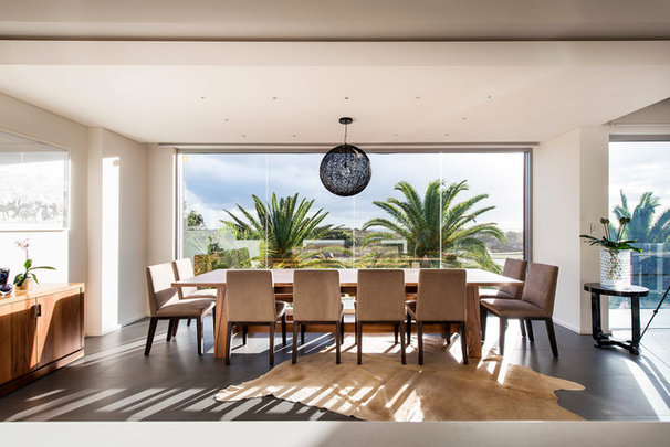 Contemporary Dining Room by D-Max Photography