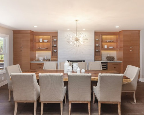 Example Of A Mid Sized Trendy Light Wood Floor And Brown Enclosed Dining Room